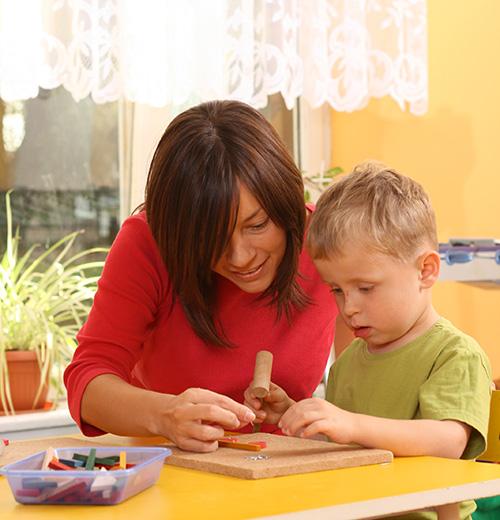 preschooler with wooden blocks